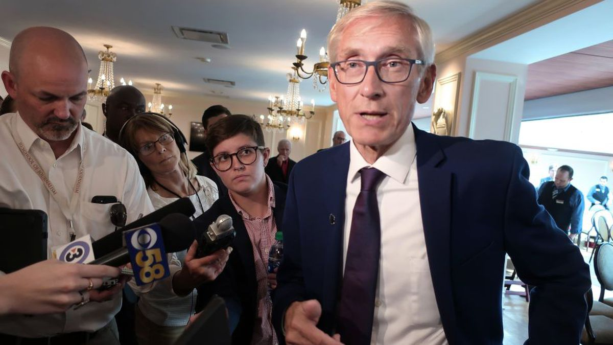 FILE - In this Sept. 24, 2019, file photo, Wisconsin Gov. Tony Evers speaks with reporters at an event in Madison, Wis. (AP Photo/Scott Bauer File)