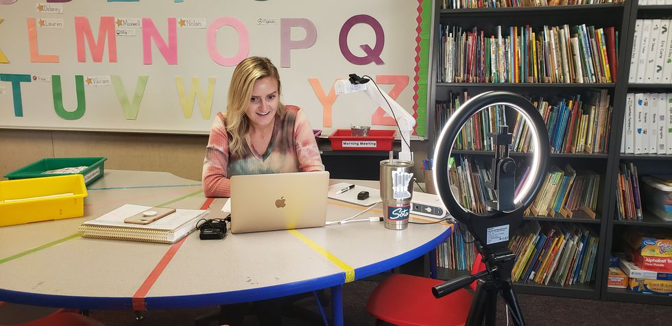 Miss Amy Aschenbeck works with one of her students during a live 1:1 learning session to focus...