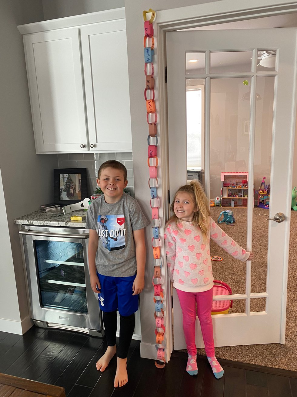 Kindergartner Aubree Reneau and her older brother, Carter, show off their countdown chain as...