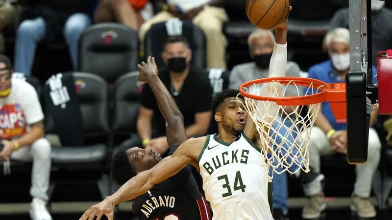 Milwaukee Bucks forward Giannis Antetokounmpo (34) shoots as Miami Heat center Bam Adebayo (13)...