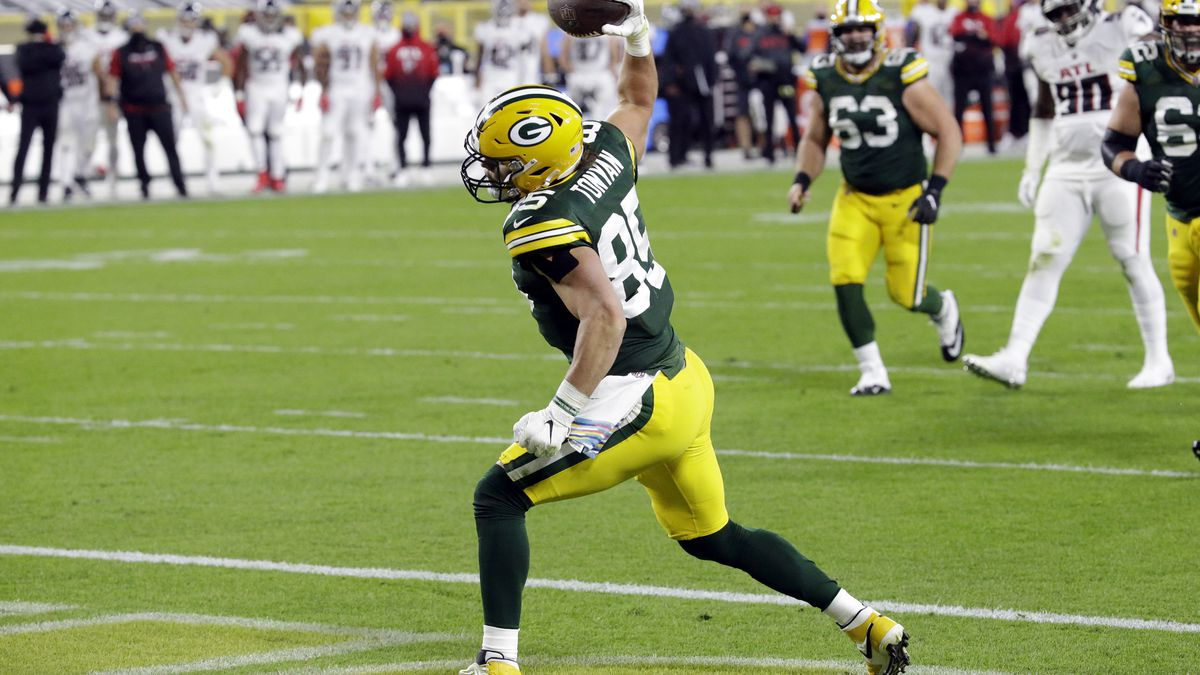 Green Bay Packers' Robert Tonyan (85) celebrates a touchdown reception during the first half of an NFL football game against the Atlanta Falcons, Monday, Oct. 5, 2020, in Green Bay, Wis. (AP Photo/Mike Roemer)