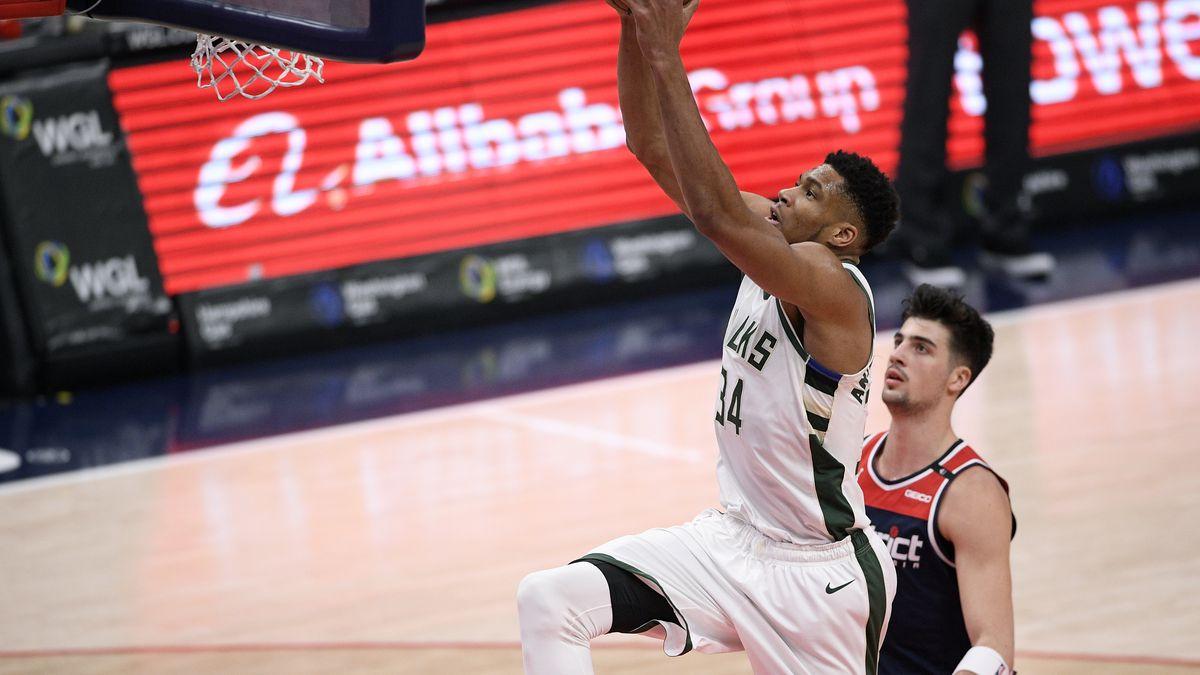Milwaukee Bucks forward Giannis Antetokounmpo (34) goes to the basket past Washington Wizards...