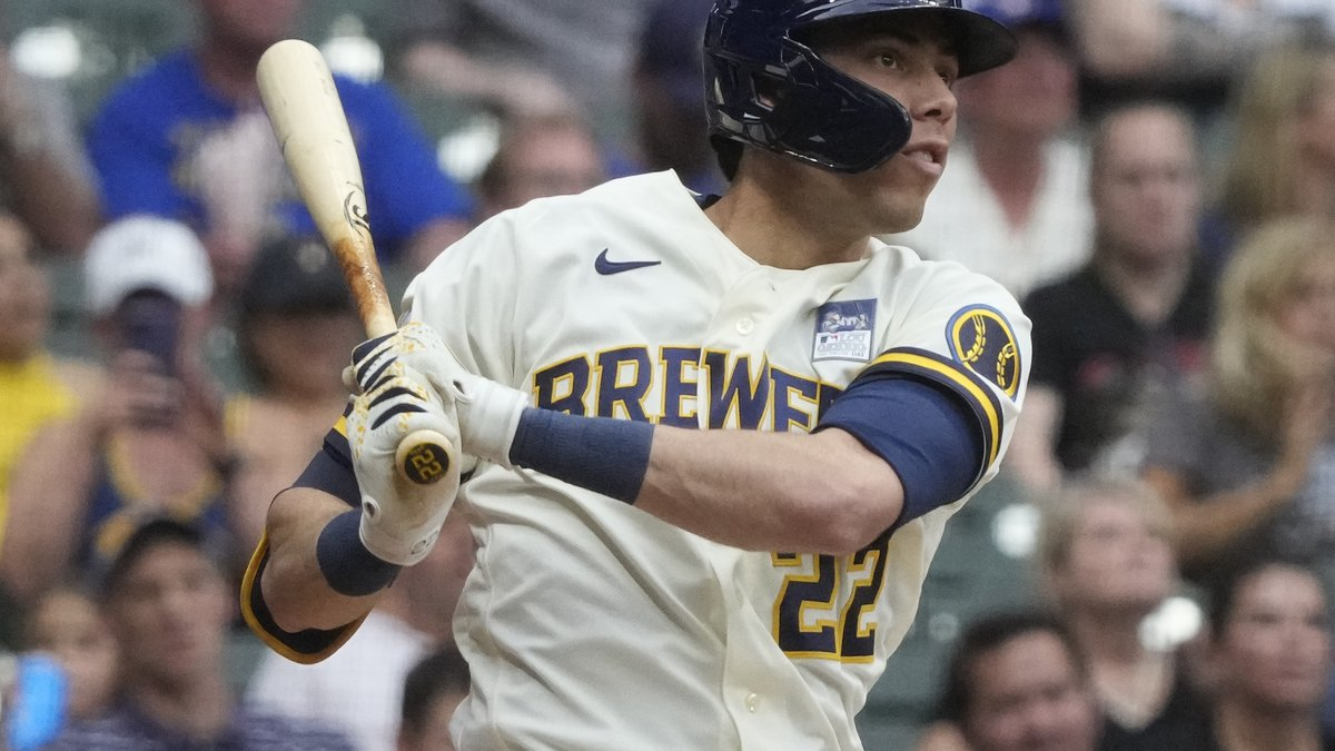 Milwaukee Brewers' Christian Yelich hits a three-run home run during the third inning of a...