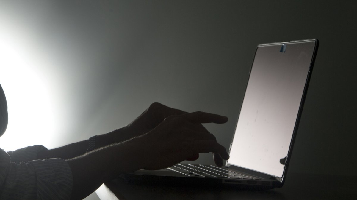 FILE - In this, Monday, Dec. 12, 2016, file photo illustration, a person types on a laptop, in...
