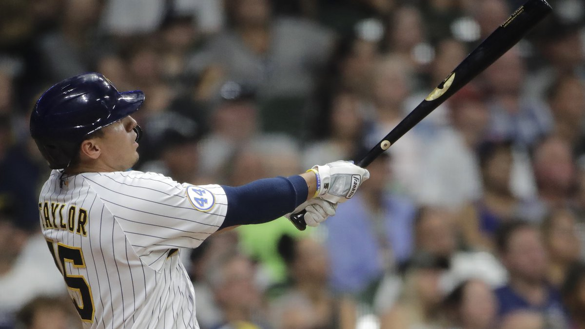 Milwaukee Brewers' Tyrone Taylor watches his grand slam during the seventh inning of the team's...