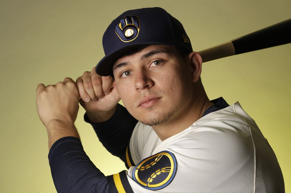 Milwaukee Brewers infielder Luis Urias poses during spring training baseball photo day Wednesday, Feb. 19, 2020, in Phoenix. (AP Photo/Gregory Bull)