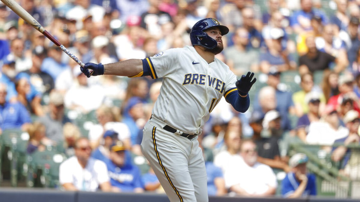 Milwaukee Brewers's Rowdy Tellez drives in a run with a sacrifice fly in the fifth inning of a...