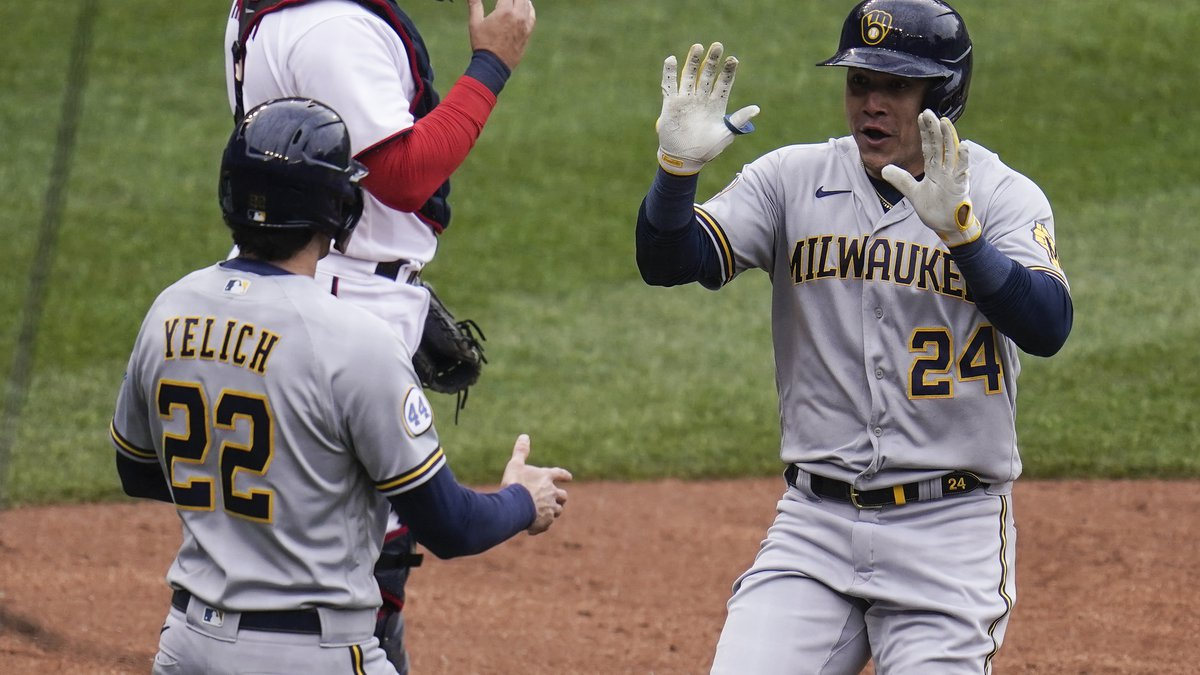 Milwaukee Brewers' Avisail Garcia, right, is greeted near home plate by Christian Yelich (22)...