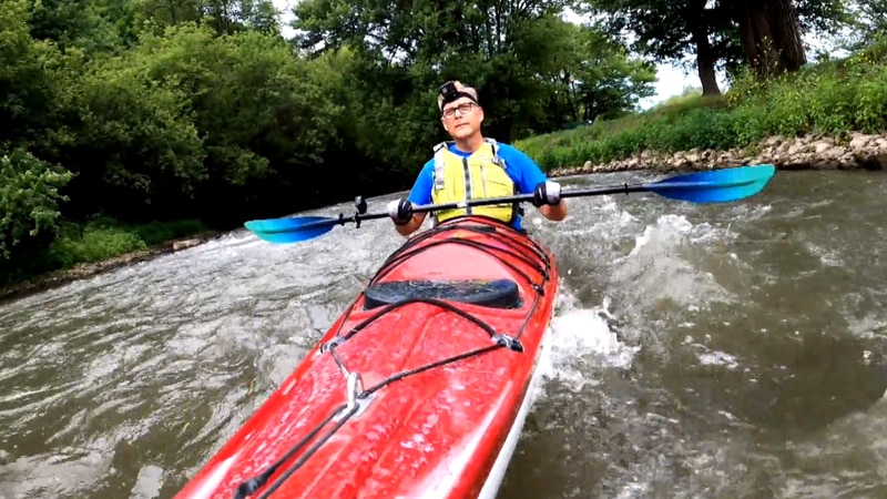 John Stofflet paddles down the small rapids on the Pecatonica River in Darlington.