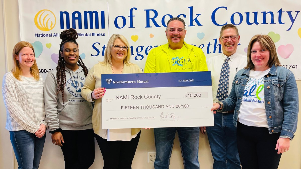 Check presentation to NAMI Rocky County members. (Left to right): Holly Sieren, Volunteer and...