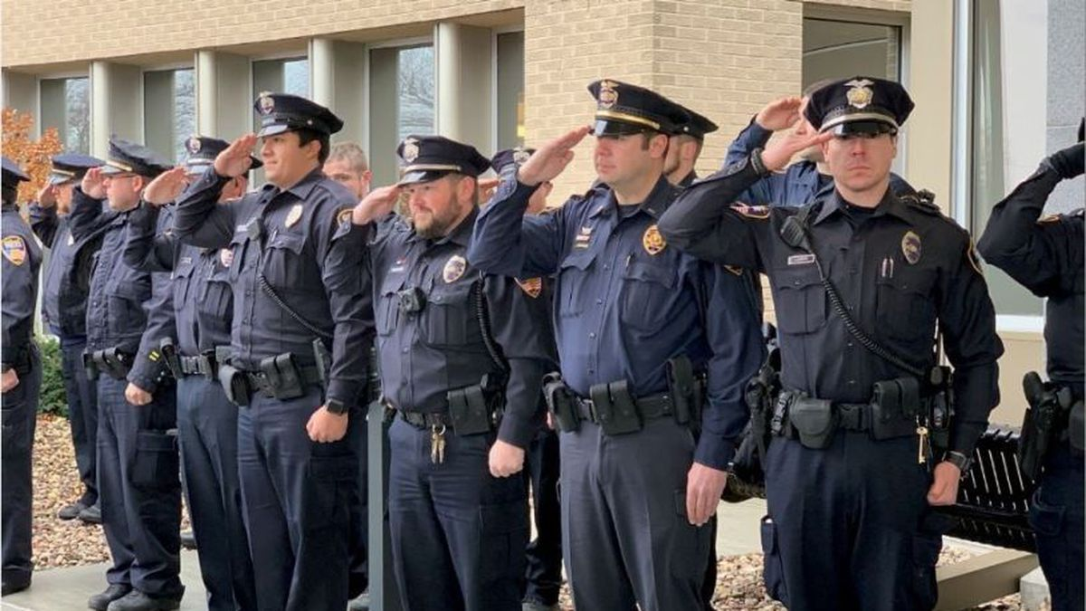 Oshkosh police officers honor Michael Wissink, who was released from the hospital Monday (Source: Oshkosh Police Department).