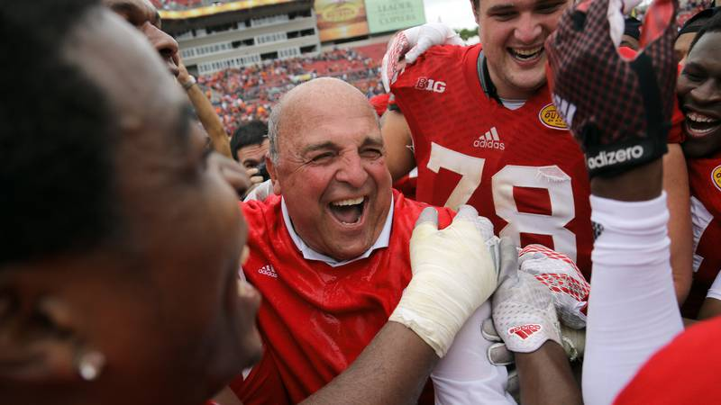 Wisconsin acting head coach Barry Alvarez laughs with his team after defeating Auburn 34-31 in...