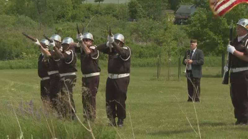 A gun salute followed by taps in Madison