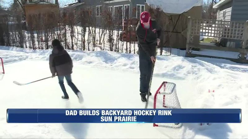 Dad builds a hockey rink in their back yard