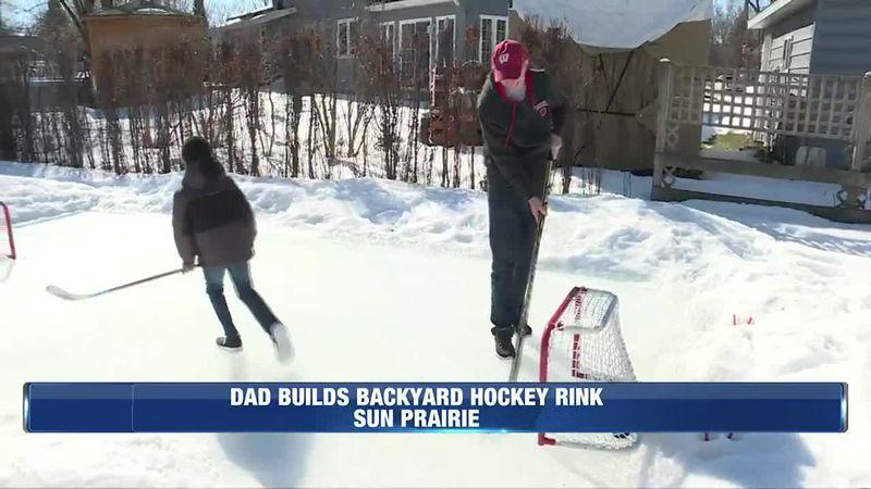 Dad builds a hockey rink in their back yard