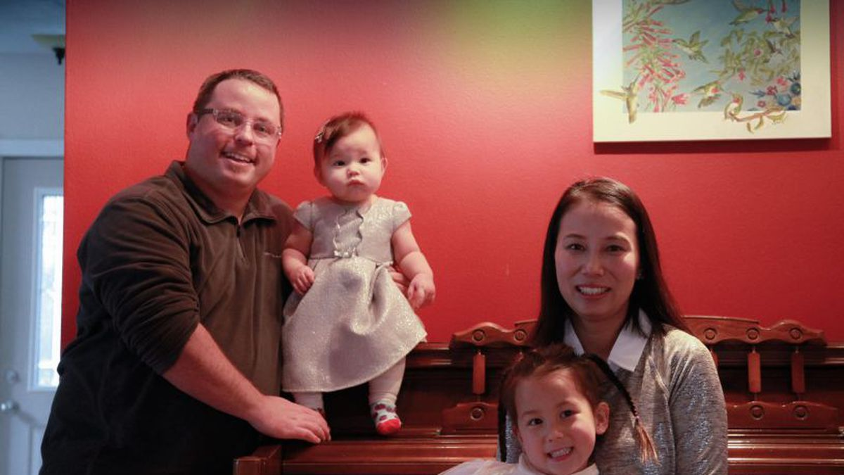 Sam Roth and his wife and two children, who are stuck in Wuhan, China amid the deadly coronavirus outbreak (Source: Sam Roth via CNN).