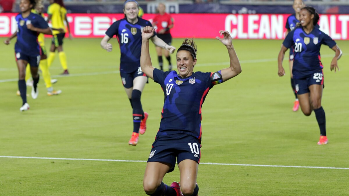 U.S. forward Carli Lloyd (10) slides on the turf after scoring in the first minute against...