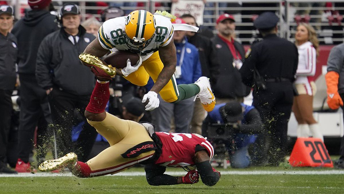 Green Bay Packers tight end Marcedes Lewis (89) is tackled by San Francisco 49ers middle...