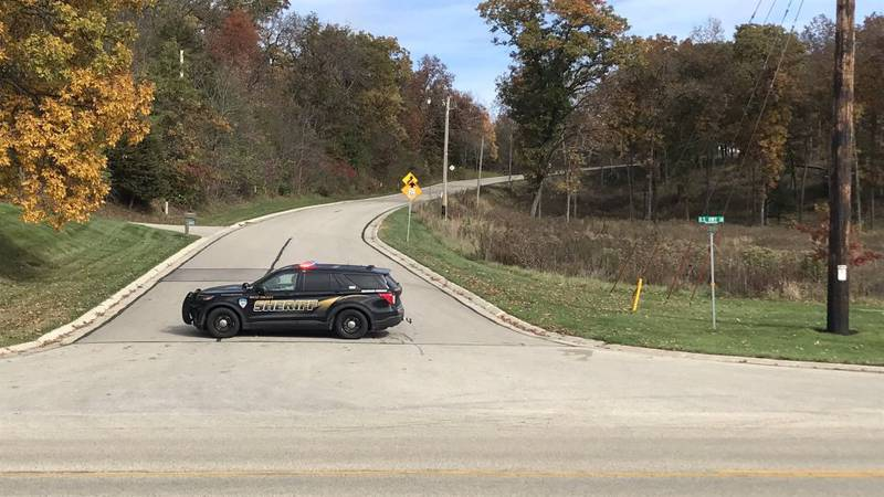 A Dane Co. Sheriff's Office cruiser blocks the road at the intersection of Hwy. 14 and Scherbel...