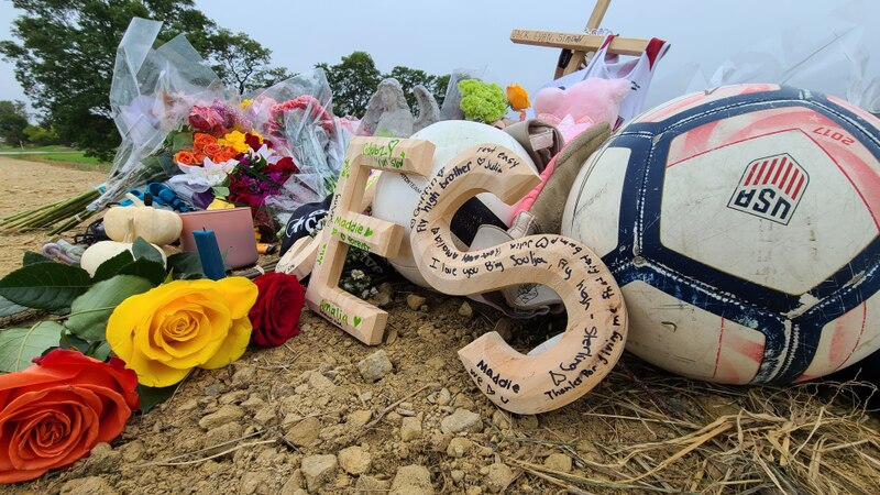 A memorial honoring the three students killed in Saturday night's crash.