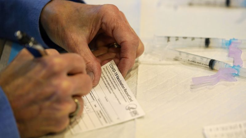 FILE - In this Tuesday, Dec. 29, 2020 file photo, a county health department worker fills out a...