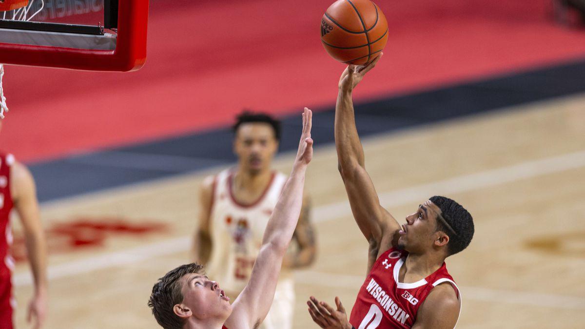 Wisconsin guard D'Mitrik Trice (0) shoots over Nebraska guard Thorir Thorbjarnarson during the...