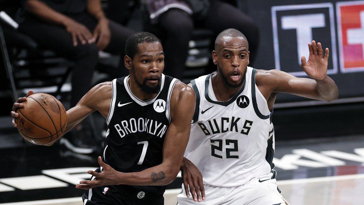 Brooklyn Nets forward Kevin Durant (7) drives to the basket past Milwaukee Bucks forward Khris...