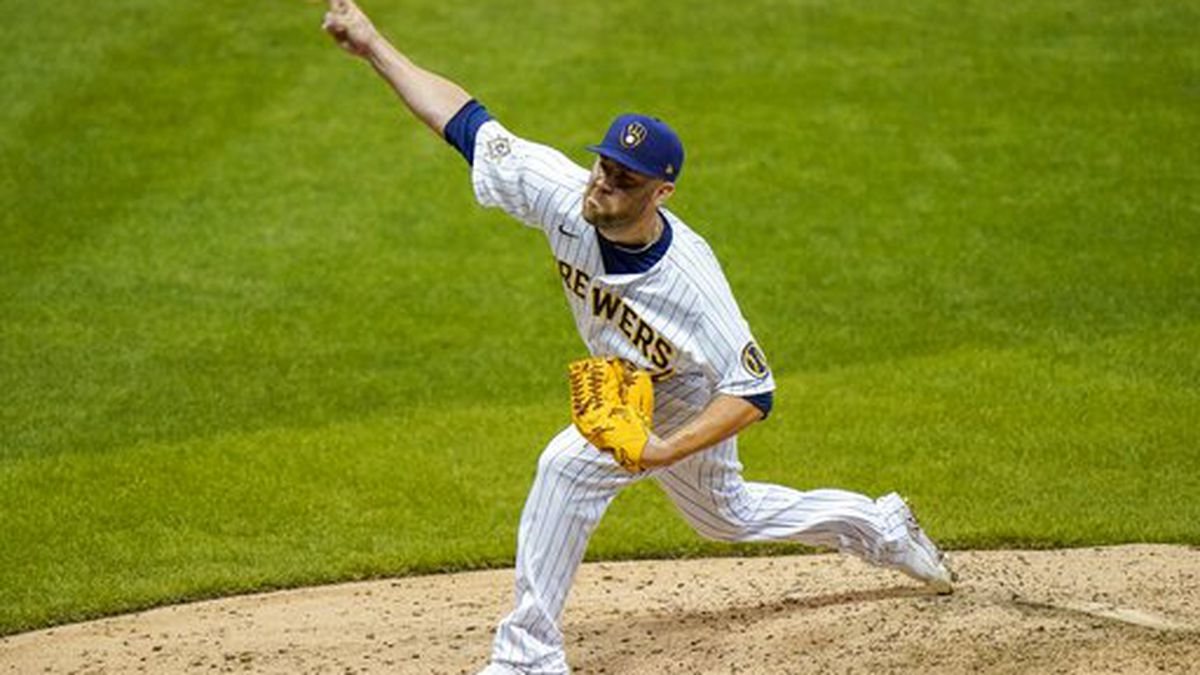 Milwaukee Brewers relief pitcher David Phelps throws during the seventh inning of a baseball game against the Pittsburgh Pirates Friday, Aug. 28, 2020, in Milwaukee. (AP Photo/Morry Gash)