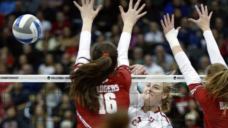Stanford's Kathryn Plummer (2) spikes around the block by Wisconsin's Dana Rettke (16) during...