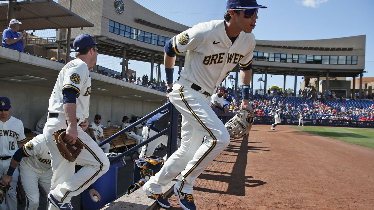 Milwaukee Brewers' Christian Yelich runs onto the field for a spring training baseball game against the Los Angeles Angels, Sunday, March 8, 2020, in Phoenix, Ariz. (AP Photo/Sue Ogrocki)