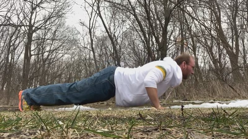 Shilo Titus does push-ups for his Facebook challenge to raise money for Stop Solider Suicide