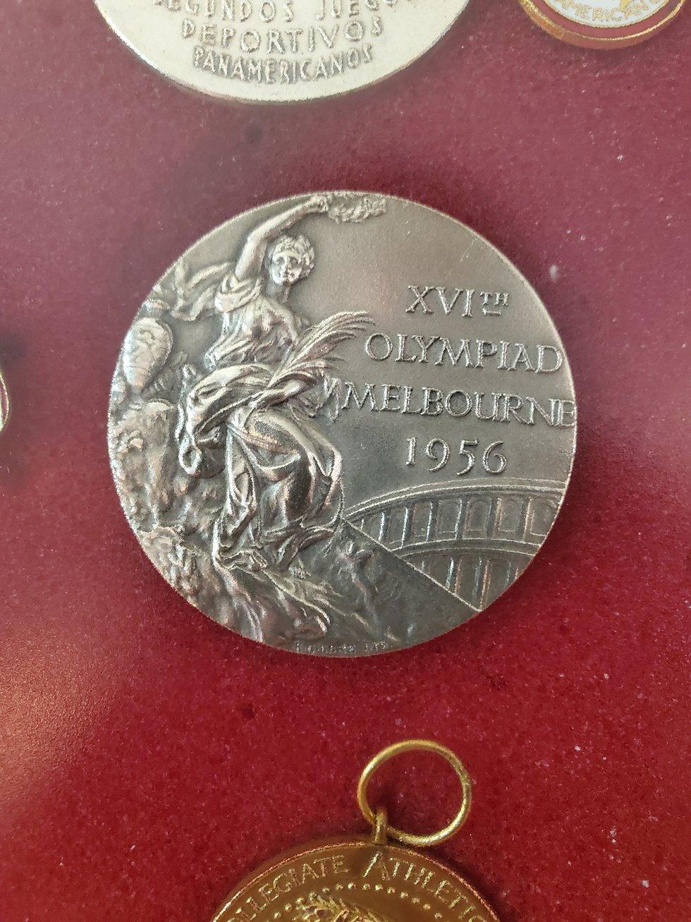 A close-up of John Bennett's 1956 silver medal