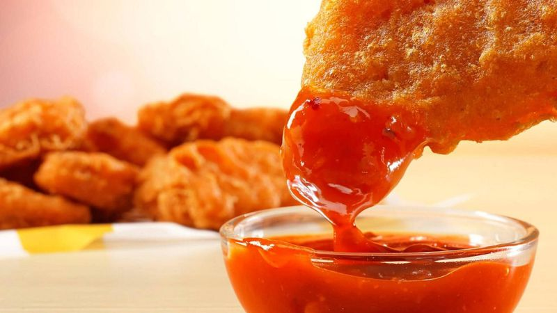 McDonald's spicy McNuggets dipped in Mighty Hot Sauce will be available for a limited time.