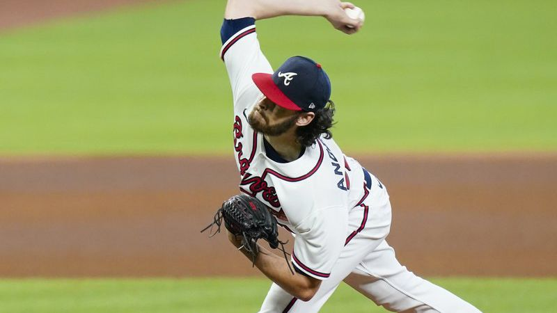 Atlanta Braves' Ian Anderson delivers a pitch during the fourth inning in Game 2 of a baseball...