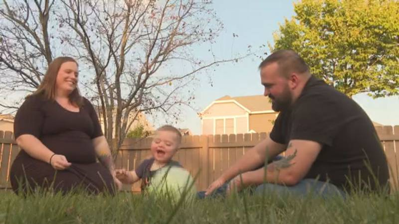 Ali and Alex Peaslee play with their son Aiden