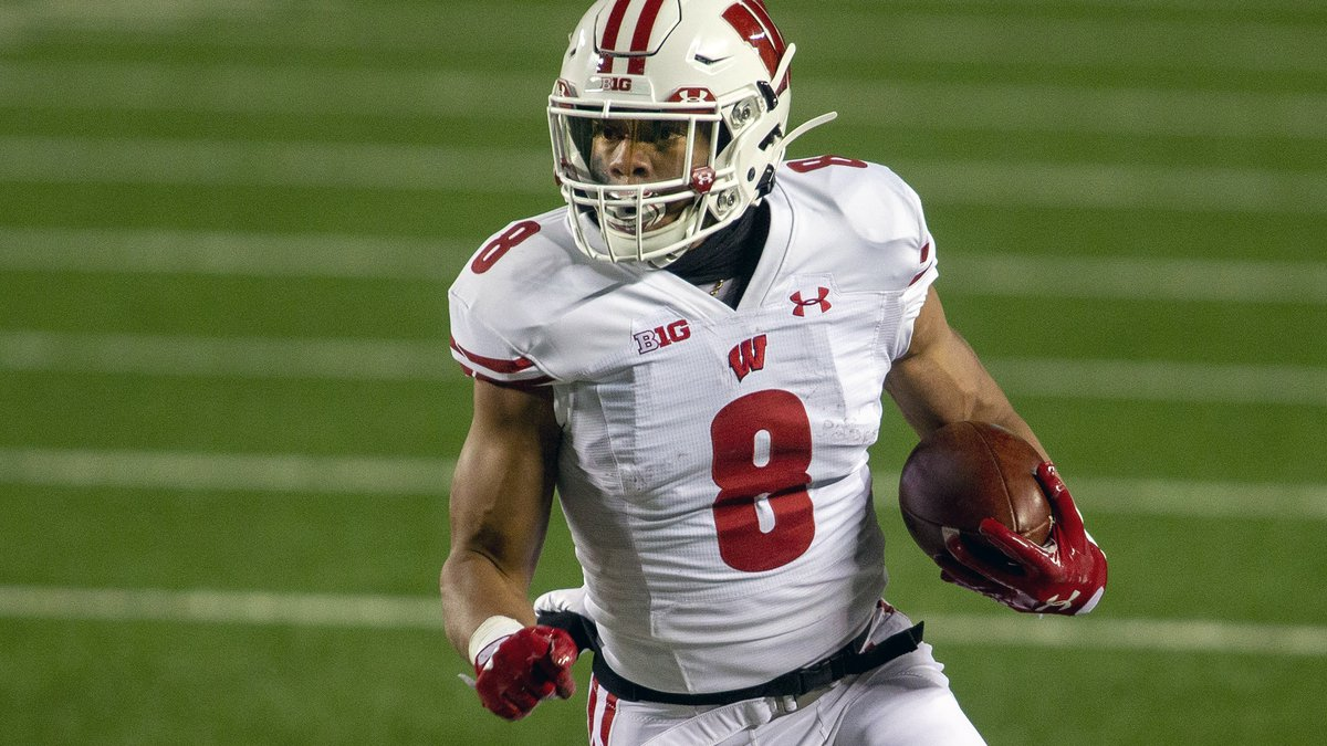 FILE - Wisconsin running back Jalen Berger (8) rushes in the first quarter of an NCAA college...