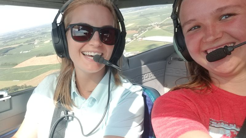"""Staff Sgt. Viney and Brianna """"Breezy"""" Moczynski together in the plane during a flight lesson."""