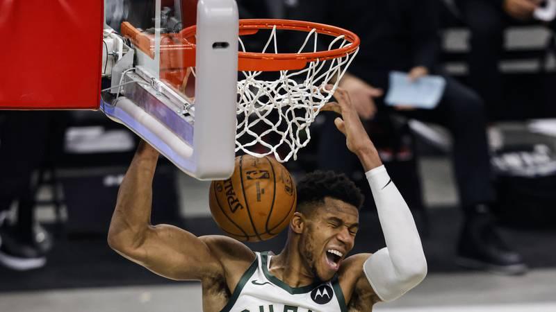 Milwaukee Bucks forward Giannis Antetokounmpo (34) dunks the ball against the Miami Heat during...