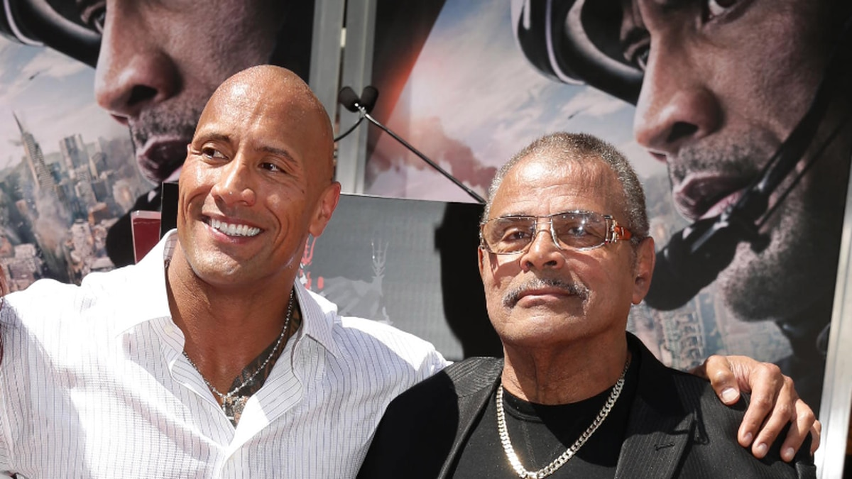 Dwayne Johnson and Rocky Johnson seen at Dwayne Johnson's Hands and Footprints Ceremony held at TCL Chinese Theatre on Tuesday, May 19, 2015, in Hollywood. (Photo by Eric Charbonneau/Invision for Warner Bros./AP Images)