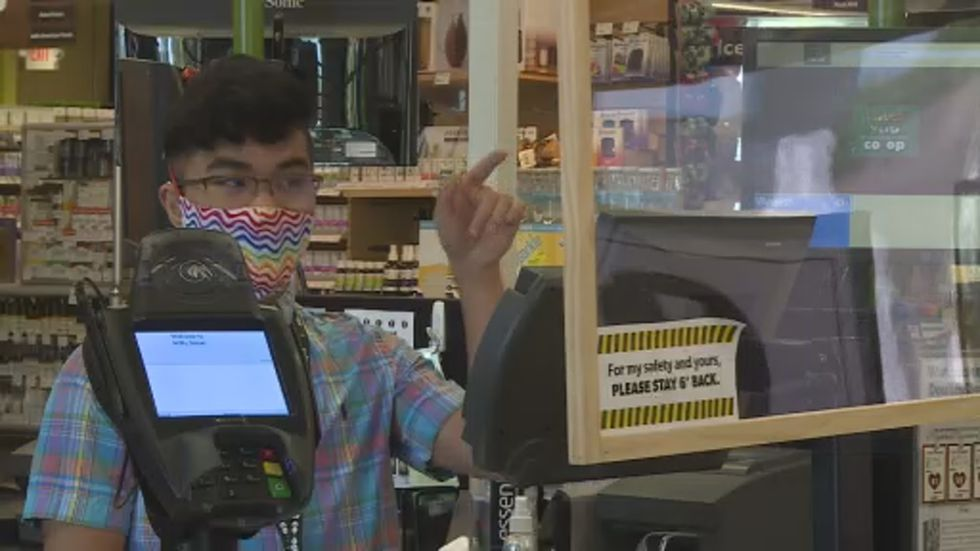 Mateo Guiao works the register at Willy Street Co-op in Middleton.