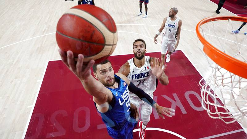 United States' guard Zachary Lavine (5) drives to the basket past France's Rudy Gobert (27)...