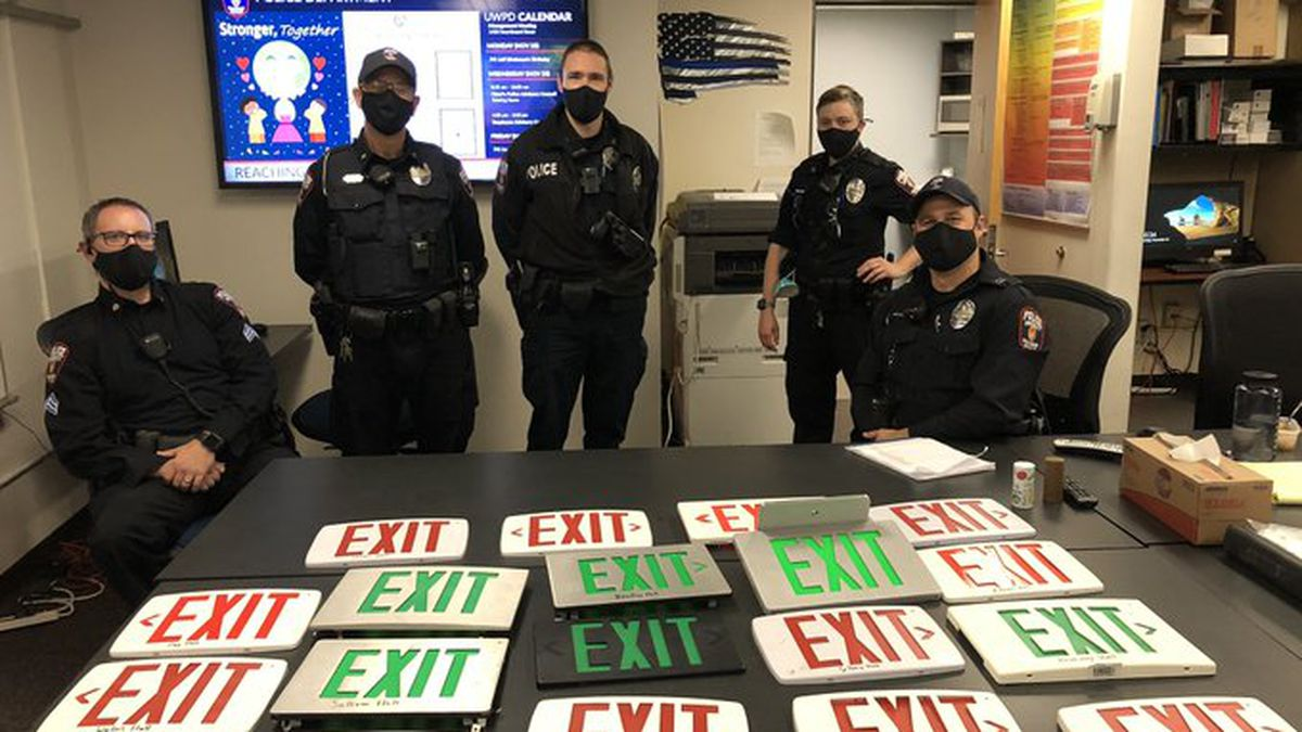 UWPD poses with the 18 signs stolen by a a pair of students from UW dorms.