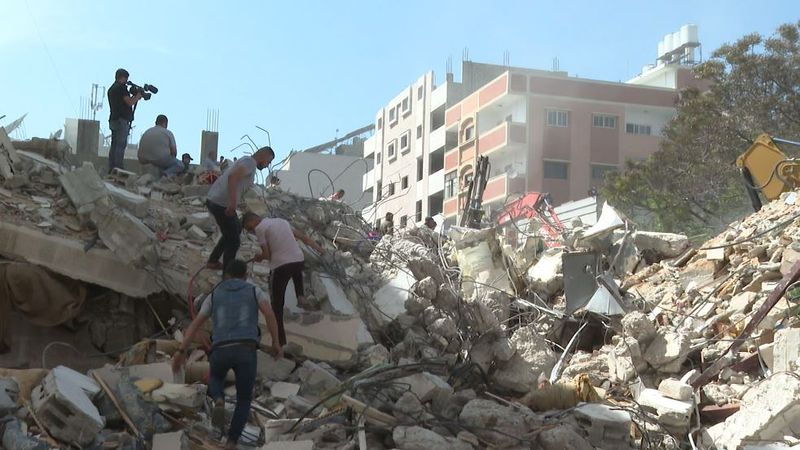 An Israeli airstrike early Sunday hit two civilian buildings, killing at least two Palestinians...