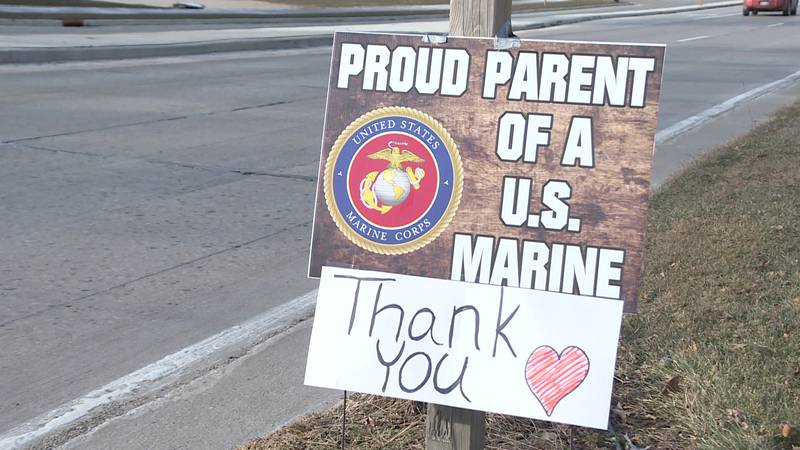This sign outside of Jodi Dushack's home in Sun Prairie was given to her from Sherri Scott,...