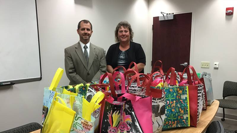 District Attorney Klomberg and Detective Brugger with donated care packages.
