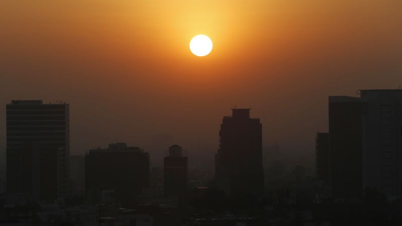 In this Thursday, Feb. 20, 2020, file photo, the sun rises amid smog during the dry season in...
