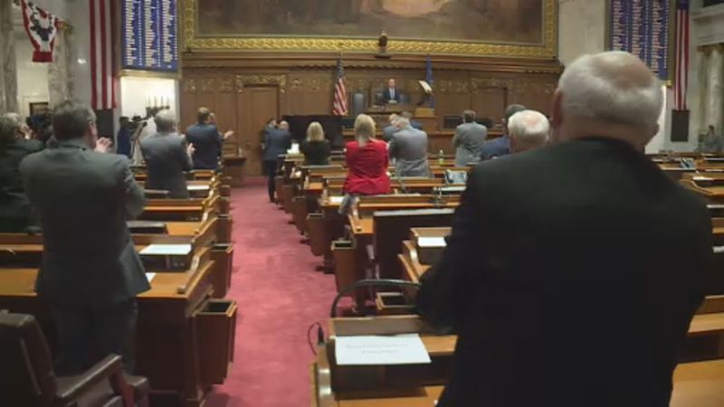 Republicans in the Wisconsin State Assembly applaud Tuesday night as Speaker Robin Vos gives...