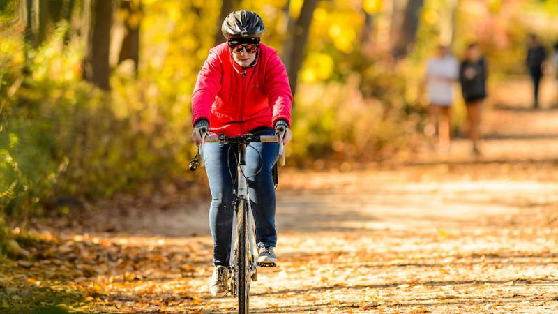 A bicyclist rides on the Howard Temin Lakeshore Path in fall 2016. Photo: Bryce Richter
