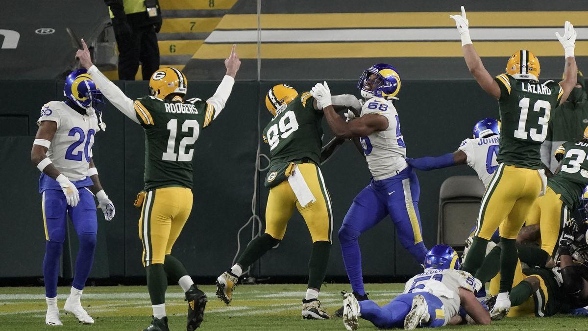 Green Bay Packers quarterback Aaron Rodgers (12) celebrates his touchdown pass to Aaron Jones...
