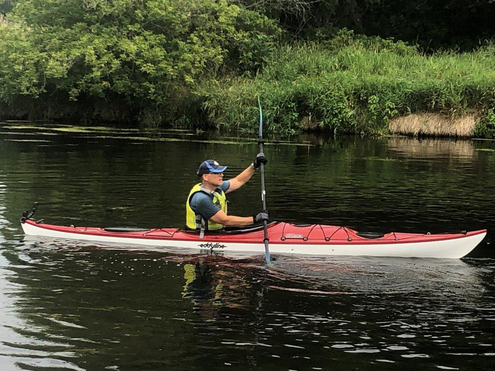 John Stofflet paddles Turtle Creek just upstream of the Tiffany Stone Bridge.